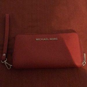 Michael Kors Bags - Michael Kors Orange wristlet wallet